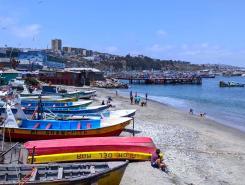 Boats arranged on the beach in Paita, Peru.