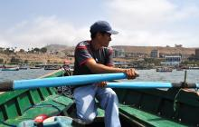 Photo of Pedro in a fishing boat